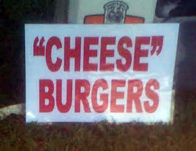White sign advertising cheese burgers