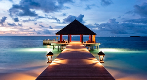 A softly lit pier with gazebo at the end of it