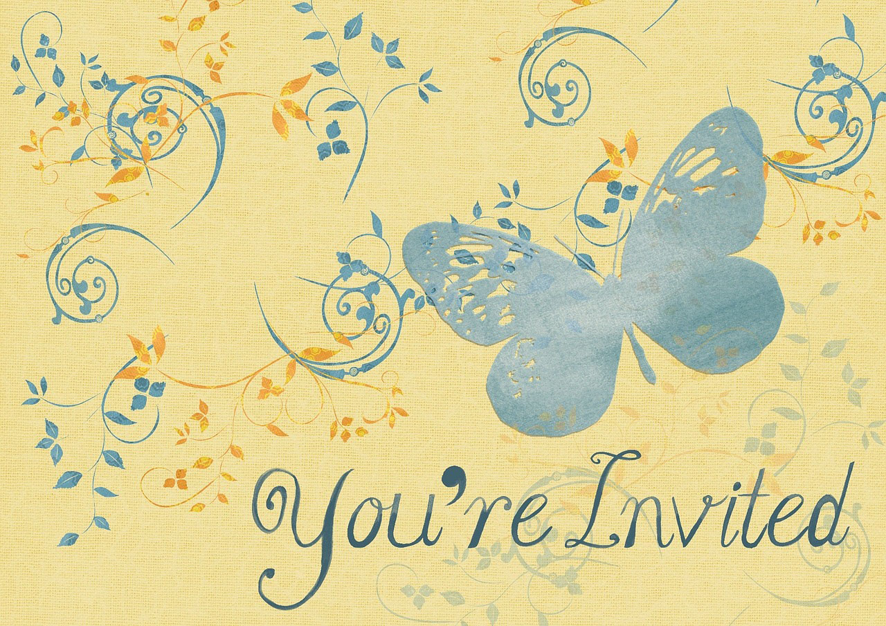 An invitation with a yellow background, a pale blue butterfly and lots of scrolls and vines scattered across it